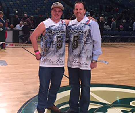 Dr James Lynch and Roy tuscany at high fives spine nevada night, reno bighorns